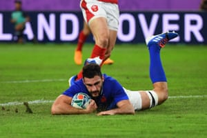 France's flanker Charles Ollivon scores their second try.