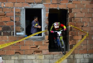 Ecuadorean downhill rider Mario Jarrin competes during the Adrenalina Urban Bike race final