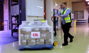 Workers at CSL roll out onto a truck the first batch of the AstraZeneca vaccine on 24 March 2021 in Melbourne, Australia.
