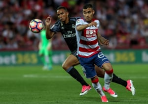 Real Madrid's Danilo is challenged by Granada's Andreas Pereira.