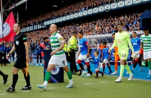 Celtic's Scott Brown and Fraser Forster walk out before the match.