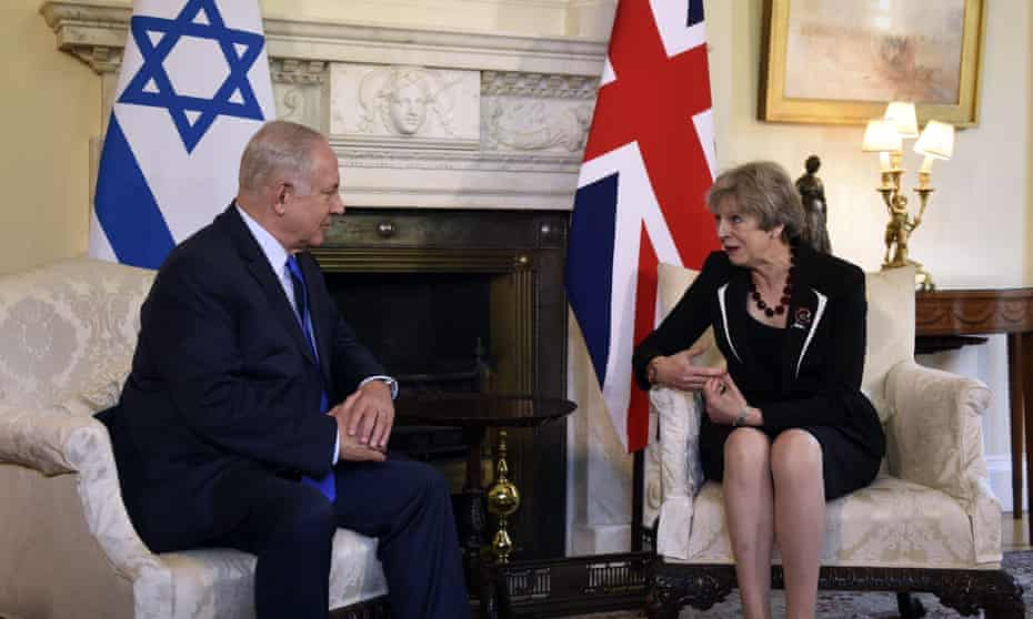 Theresa May and Benjamin Netanyahu sit and talk in Downing Street