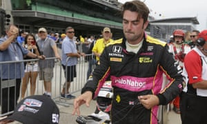 Jack Harvey walks past fans during qualification for the Indy 500. Harvey is a team-mate of Fernando Alonso, who is making a one-off switch over from the McLaren Formula One team.