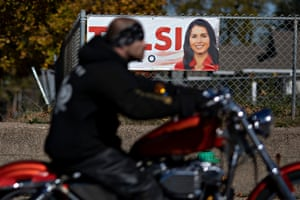 A motorcyclist passes a banner supporting 2020 presidential candidate Rep. Tulsi Gabbard (D-Hawaii), outside a home in Des Moines, Iowa on October 25, 2019.