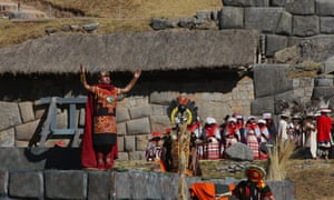 Standing atop the Ushnu, the Sapa Inca opens his arms to salute the sun.