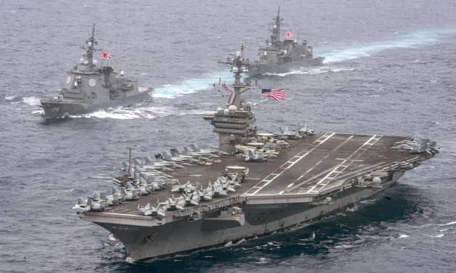 The USS Carl Vinsonsails through the Philippine Sea with the Japanese destroyers.