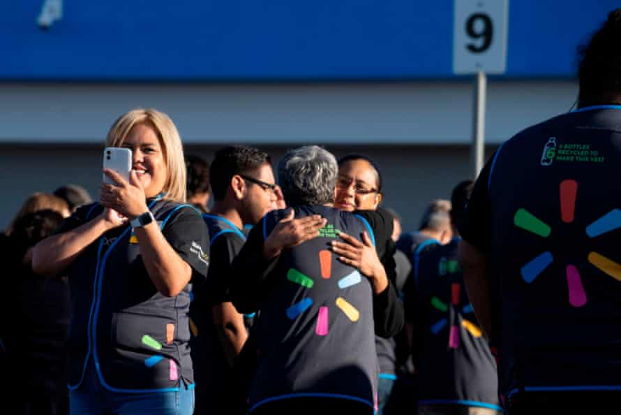 Employees gather before the opening of the Walmart store in El Paso, Texas, which was the site of one of the deadliest mass shootings in modern US history.