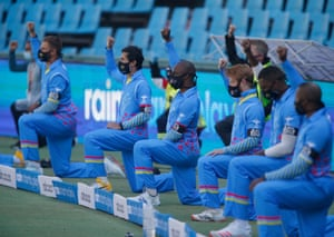 Players take a knee before a 3TC Solidarity Cup cricket match at SuperSport Park, Pretoria, in July