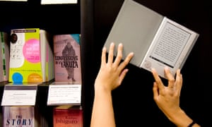 an e-reader next to books on display in a branch of Waterstones.