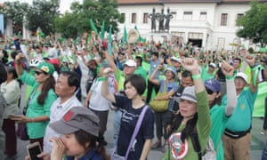Demonstrators protest against the construction of a government housing project on the forested land around Doi Suthep mountain