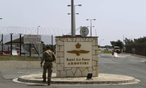 A British soldier at the gated entrance to RAF Akrotiri