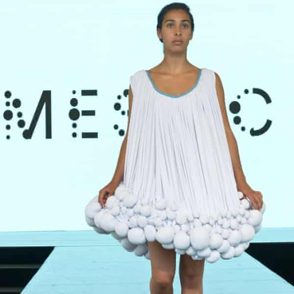 A model wears a dress made with Mestic.