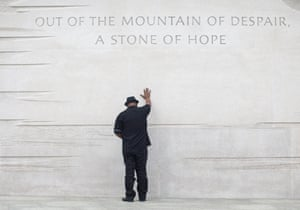 Rev Bobby Turner of Columbus, Ohio, places his hand on the Martin Luther King Jr Memorial in Washington DC. King was the first African-American honoured with his own memorial in the National Mall area.