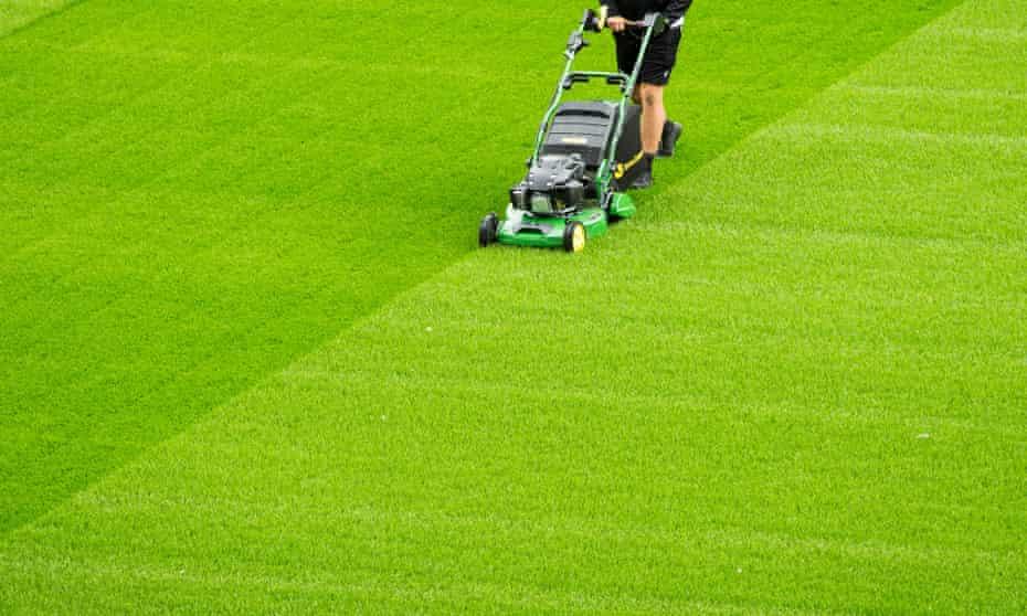 A groundsman cuts the grass at Ashton Gate stadium, Bristol.