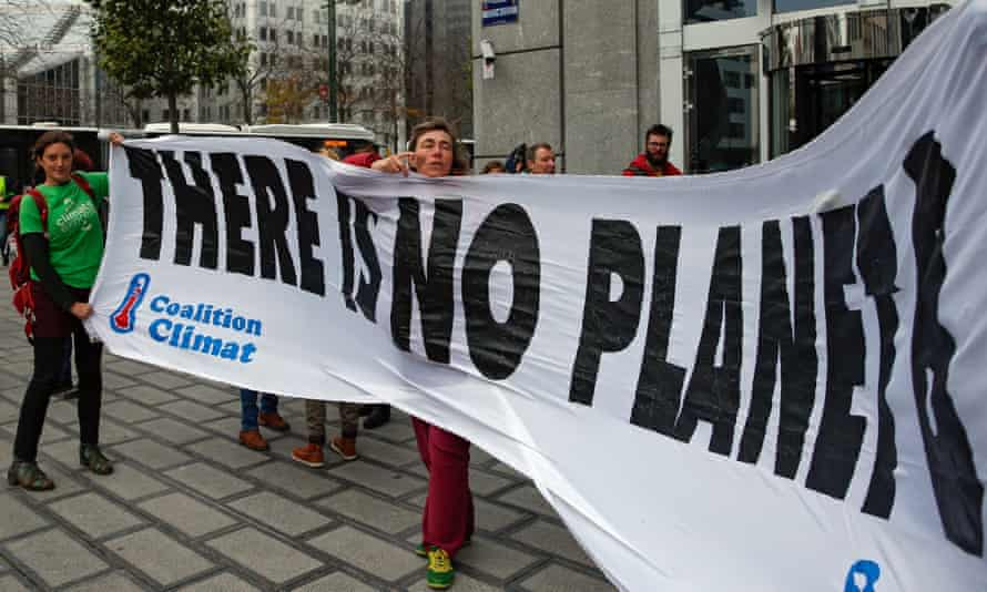 Environmental activists on the Brussels climate march in Brussels, to ask governments to deliver on environmental policy before the UN conference on climate change in Paris