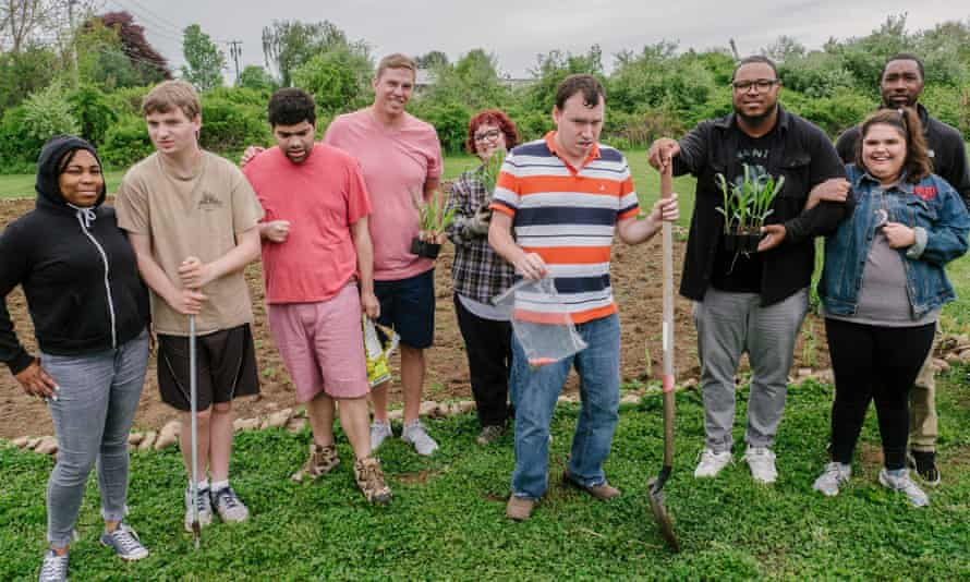 Young adults from Milestones Behavioral Services at their plot in Watson's fellowship garden in Orange, Connecticut