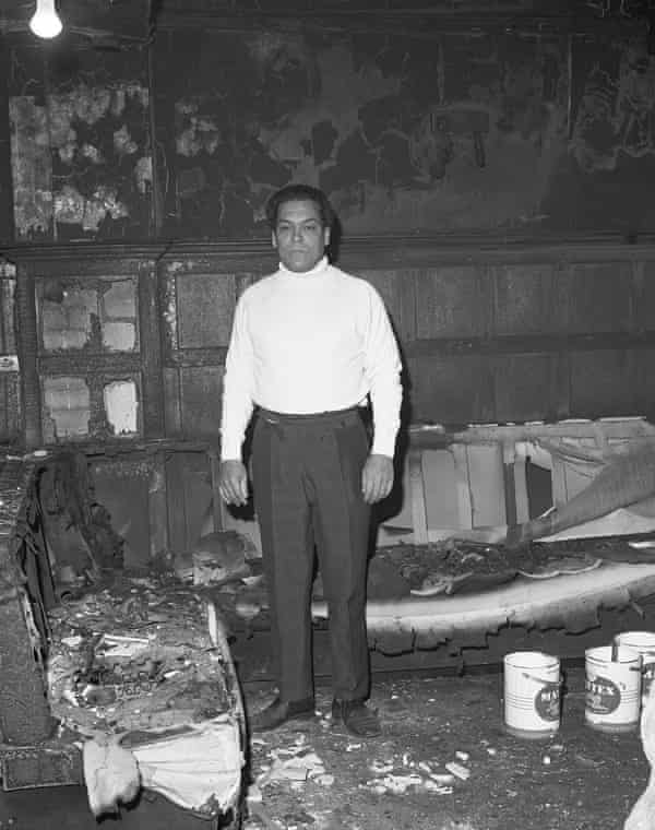 George Berry in his pub the Coach & Horses after it was burned down in the 1970s.