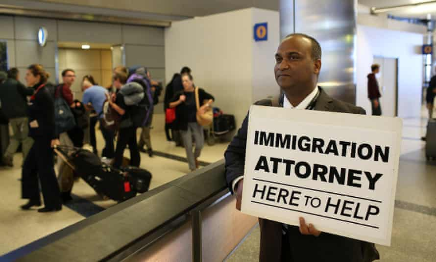 Volunteer immigration attorneys offer to help as people gathered at LAX on 31 January to protest against the travel ban.