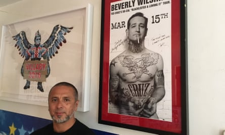 The artist Sabo beside the Ted Cruz poster that made his name.