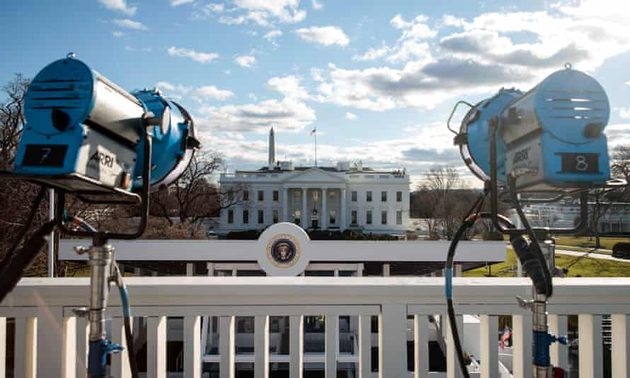 Television lights are set up near the White House as Washington prepares for Donald Trump's inauguration.
