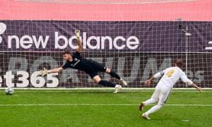 Sergio Ramos slots the winning penalty past the Athletic Bilbao keeper Unai Simón.