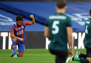 Crystal Palace's Andros Townsend takes a knee in support of Black Lives Matter.