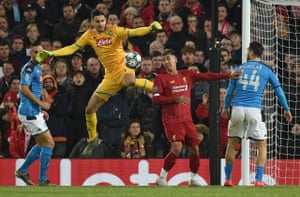 Liverpool's Roberto Firmino watches the ball after Napoli's goalkeeper Alex Meret makes a mess of a cross.