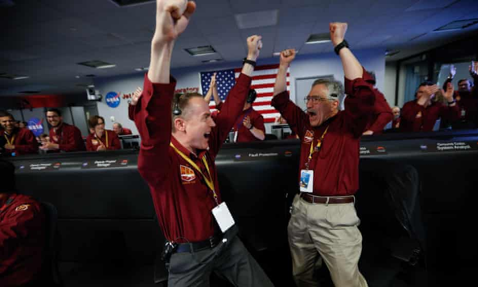 Celebrations among the mission control team at Nasa's Jet Propulsion Laboratory in Pasadena.