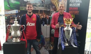 the writer and his godson with FA Cup and Premier League replica trophies