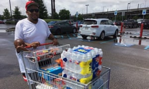 Terrence Williams and his son buy supplies