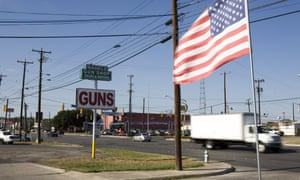 Street in San Antonio, Texas, with a sign saying 'Guns'