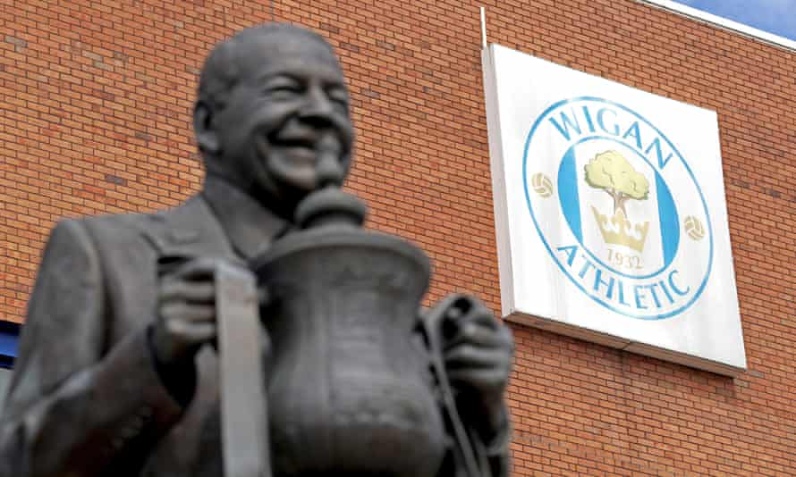 Statue of Dave Whelan with the FA Cup.