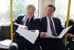 Boris Johnson and David Cameron on an Underground train.