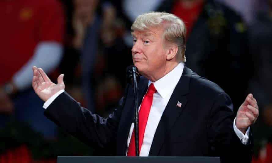 U.S. President Donald Trump speaks at a rally in Pensacola, Florida, U.S., December 8, 2017. REUTERS/Carlo Allegri