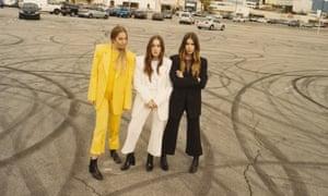 Haim with the band … (l-r) Este, Danielle and Alana.