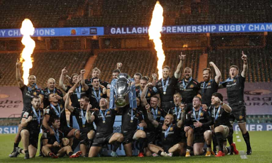 Exeter players celebrate with the Premiership trophy after victory in the rain at Twickenham.