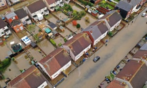 An aerial view of houses and cars submerged under water following severe flooding in Doncaster
