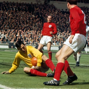 England goalkeeper Gordon Banks holds onto the ball, watched by Ray Wilson and George Cohen, during the 1966 World Cup Final against West Germany at Wembley Stadium