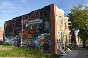 The side of a house, painted by Rameen Aminzadeh, is dedicated to those killed by police violence and to Freddie Gray, who was arrested on this street