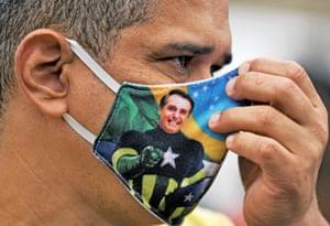 Rio de Janeiro, Brazil A supporter of President Bolsonaro wears an appropriate mask during a demonstration at Copacabana beach