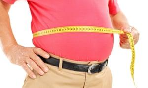 Fat man measuring belly
