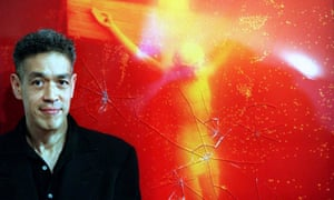 Andres Serrano in 1997 in front of his work Piss Christ after it was vandalised.