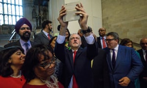 Jeremy Corbyn takes a selfie with Labour MPs in Westminster Hall in the Houses of Parliament, London.