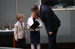 The treasurer is greeted by two of his children – daughter Adelaide and son Xavier, who take the chance to leaf through their dad's handiwork.