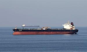 Oil tankers pass through the strait of Hormuz.