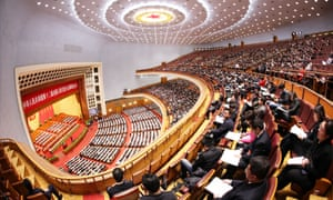 Delegates attend a session of National People's Congress at the Great Hall of the People, where the Cultural Revolution concert was staged.
