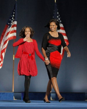 Michelle Obama wearing a Narciso Rodriguez dress, with her daughter Malia at the election night victory rally for Barack Obama, 4 November 2008, Grant Park, Chicago, Illinois.
