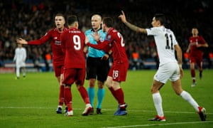 Liverpool's Roberto Firmino, Andrew Robertson and Jordan Henderson badger referee Szymon Marciniak as Angel Di Maria protests his innocence.
