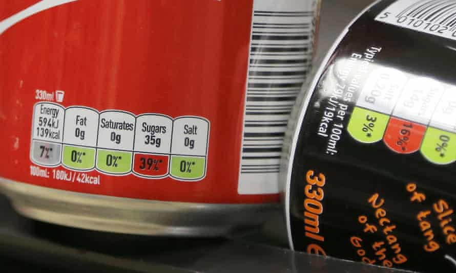 Drinks cans labelled with their sugar content.