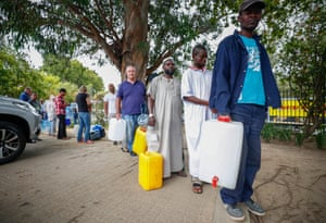 A social leveller? Cape Town residents queue to collect drinking water from a mountain spring.